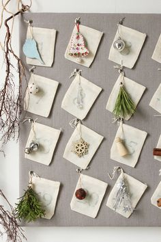 DIY Advent Calendar from The Marion House ....beautiful!!  I can't decide if I should pin it to Christmas or Nature Table Inspiration.  Lovely Advent Calendar!