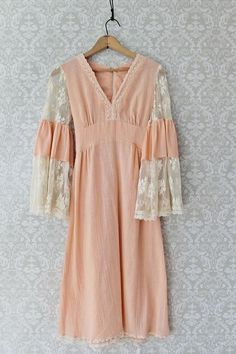 Gossamer vintage 1960's dress. Entirely done in a beautiful, peach colored cotton gauze accented with creamy eggshell. The delicate, lace, bell sleeves and intr