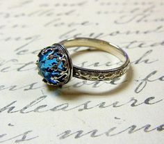 I found 'Beautiful Gothic Vintage Sterling Silver Floral Band Ring with Rose cut Blue Topaz and Heart Bezel' on Wish, check it out!
