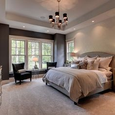 Bedroom grey gray upholstered bed large windows chandelier monochromatic