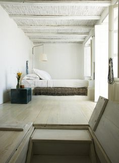 Attic room inspiration for low stud spaces... low bed, white walls / ceiling, light floors