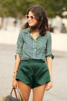 83 Runway-Ready Outfit Ideas From New York Fashion Week | TeenVogue.com, Leandra Medine in a cool pair of green satin shorts, green and white delicate pattern button down shirt, emerald green satin shorts,
