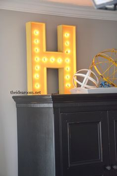 Make your own Lighted Sign using your initial. Easy to follow tutorial and step by step photos so you can build one too. It is easier than you would think!