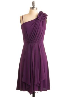 Modcloth Hibiscus at the Hop Dress  The ruffled petals on its one shoulder are perfectly perched over a swooping sash that sheerly cascades past a hidden side zip like Waimoku Falls, and makes way for the flowered jewelry you wear to match rosetted heels. I