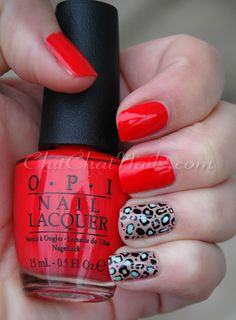 """""""I started out with two coats of OPI Red Light Ahead… Where? For the accent fingers I used two coats of Revlon Grey Suede, and stamped the cheetah print with Konad plate m57 and Sally Hansen Black Creme.  I added in some accents with Revlon's Minted as well."""""""