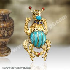 Egyptian 18K Gold pendant scarab with light blue stone. A truly unusual, stunning, and beautifully styled handmade gold scarab pendant decorated Turquoise stone and red enamel.