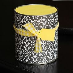 Decorated Tin Can.  Attach a handle & add the gift inside.  Great idea for a teacher's gift.