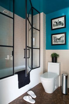 Instead of using the standard, manufacturer's glass doors try using other types of doors and windows like these factory windows as your shower enclosure.