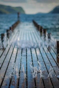 pier with splashing water