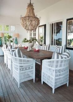Most outdoor wicker furniture is made from rattan, the most common plant stem used in wicker manufacturing. Patio Dining, Dining Chairs, Wicker Chairs, Dining Rooms, Rustic Furniture, Outdoor Furniture Sets, Adirondack Furniture, Outdoor Chandelier, Bead Chandelier