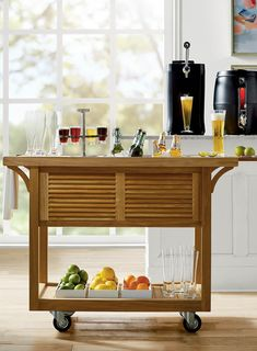 From top to bottom, we designed this handsome teak cart to be the ultimate outdoor beverage center. Beautifully crafted from grade-A teak, its top panels slide open to reveal a high-quality stainless steel beverage tub and companion ice bucket.