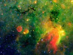 In IRDC G11.11-0.11, thick clouds of dust and gas are congealing into stars so dark that humans living there would see an empty night sky. The image shows vast glowing fields of gas and dust, indicating that much of this dust is heated by forming stars. The centers of some clouds, such as the snake-like structure on the upper left, are so thick and cold that they are dark even in infrared light. The unusual red sphere below the snake is actually a supernova remnant.