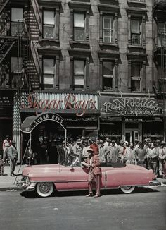 Boxer Sugar Ray Robinson leaning on his 1950 pink Cadillac convertible in front of two of his businesses (including restaurant) in Harlem St.) // (Photo by George Karger/Pix Inc. Sugar Ray Robinson, Chevrolet Chevelle, Chevrolet Silverado, Cadillac Rosa, Pink Cadillac, Aston Martin Vanquish, Bugatti Veyron, Harlem History, Boxing History