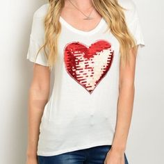 Red Sequin Heart Tee Super cute and soft Ivory tee with a red sequin heart in the middle. Can be paired with absolutely everything! Made of Rayon/spandex blend. Bchic Tops Tees - Short Sleeve