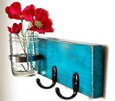 Wall key hanger with vase.