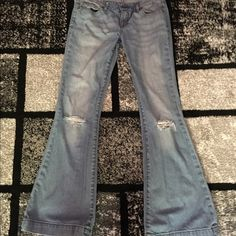 Express Stella Fit & Flare Jeans Distressed These light wash, distressed jeans have a flared leg and wide cuffs. They are in like-new condition and have a very flattering fit. These look great with heels. Express Jeans Flare & Wide Leg