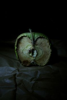 A photographic image, showing what happens when Apples decay. The use of dark background, dark lighting and dark surface that contrasts with the green decaying apple emphasises a sort of death theme in this image. As decay symbolises death. Fruit Photography, Time Photography, Still Life Photography, Texture Photography, The Art Of Photography, Landscape Photography, Backlight Photography, Photography Composition, Object Photography