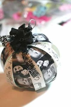 DIY Photo Christmas Ornament. Great gift idea. Make an ornament with favorite photos from the year. Could be a tradition! by Bigthighqtpie