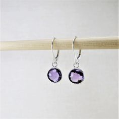 There is something about these amethyst earrings that just cannot be denied. Dainty and lightweight, they Amethyst Earrings, Amethyst Gemstone, Drop Earrings, Born In February, Modern Jewelry, Unique Gifts, Jewelry Design, Minimalist, Gemstones