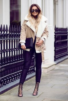 Sarah Ashcroft looks both cosy and chic in this beautiful beige shearling coat by Jessica Buurman. To steal this fresh and original style, wear a shearling jacket with leather leggings and a pair of...