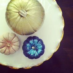 The Pretty Purveyor: painted pumpkins!  Gold spray paint, and sponge brushed acrylics with a dash of glitter.