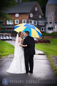 Kelly and John at Farmstead.  #umbrella #rain #farmstead #bride #groom #wedding #mrandmrs #justmarried #weddingday #happycouple #aziccardi #anthonyziccardistudios