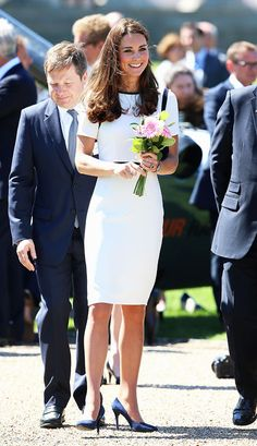 Kate Middleton looks lovely in a nautical Jaeger dress and matching Alexander McQueen heels.