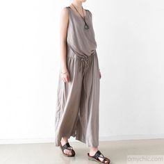 gray summer linen jumpsuit pants plus size wide let pants unique tunic trousersThis unique deisgn deserves the best quality texture. The fabric of this article is soft, comfortable and breathy.Flattering cut. Makes you look slimmer and matches easlily with jeans, leggings stylish pants or skirts. Measurement: One size fits all for this item. Please make sure your size doesn't exceed this size: XL/US16-18/EUR44      Shoulder 39cm / 15.21