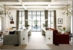 Betty Burgess, of Betty Burgess Design, uses a pair of BRADLEY concrete 'Owen' Console Tables and 2 'Clint' Sofas.  www.BRADLEY-USA.com