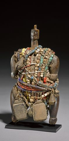 Africa | Fertility doll from the Namji people of Cameroon or Nigeria | Wood, glass beads, West African coins, leather, shells, metal beads and natural fiber