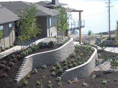 The Allan Block Blog: 4 Ways to Manage Water on a Sloping Yard