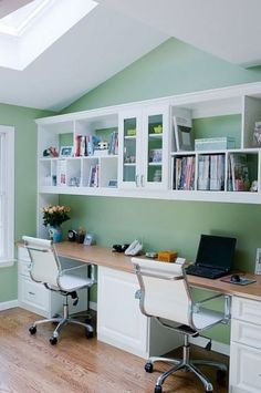 Love this for an office; however, my side of the shelves would be loaded with books, not trinkets and knick-knacks. I imagine floor-to-ceiling shelves on the opposite wall, of course =)