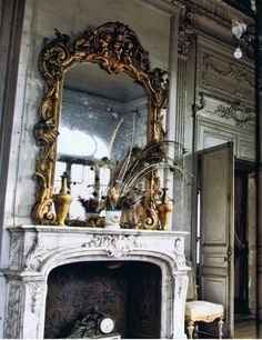 This fireplace, in all its Baroque glory, is a part of an old mansion in Paris. Can't you just imagine the up-close view, with layers of paint peeling off? I'm sure if the fireplace could talk, it could tell some amazing stories... This gorgeous mirror, found in a mansion on the outskirts of Paris, is an amazing contrast to...