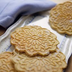 The pizzelle (peets-TSEH-leh), a crisp waffle cookie, is one of the oldest cookie recipes known. These large crisp Italian cookies are made with a pizzelle iron.