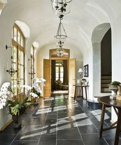 A light-filled hallway in a modernized French country–style house   archdigest.com