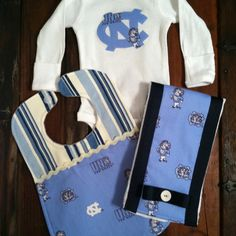 UNC Tarheels baby gift set includes onesie, burp cloth, and bib by Posh Petites Boutique. $25 Email Leann Broome at lmb0828@hotmail.com to place an order.