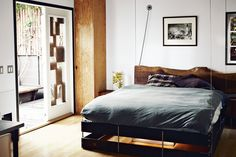 A brilliant way to save space...the bed lifts up when you aren't sleeping in it.