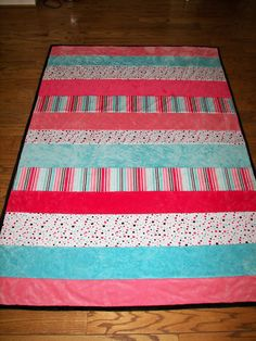 Stitch, flip and quilt as you go.  When you are done, no need to quilt!  This minky is so soft. Made my strips various lengths.