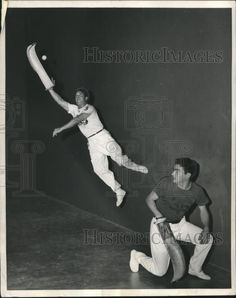 1956 Press Photo A player climbs a wall to snag the ball in a jai alai match | eBay
