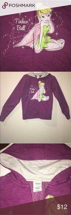 Tinker Bell Pink Disney Sweatshirt size Medium This super soft pink Tinker Bell sweatshirt is a must-have for all Disney fans! It's front pockets and hood make it perfect for any cold weather. Disney Tops Sweatshirts & Hoodies