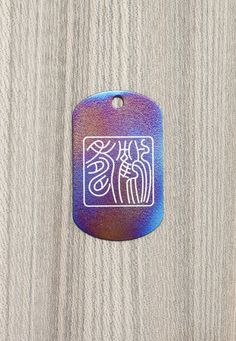 "Titanium pendant with engraved chinese characters ""Long life"" (""To live as long as cranes""). by KaeiStore, ¥4000"