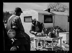 Painting wood carvings to sell a long the road side. Appalachia 1950's