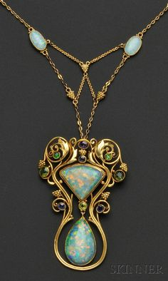 Arts & Crafts Opal and Gem-set Pendant Necklace, F.G. Hale, bezel-set with two shaped opal cabochons measuring approx. 25.00 x 16.00 x 5.50 and 23.00x 19.00 x 5.00 mm, further bezel-set with amethyst, sapphire, peridot, green tourmaline, and demantoid garnets, in a foliate mount with grape cluster motifs, suspended from a conforming chain with two bezel-set opal cabochons with black onyx backs, 18kt gold mount with 14kt gold chain, lg. 2 3/4, 16 3/4 in., signed F.G. Hale