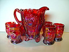 "*RED CARNIVAL GLASS ~ 6 tumblers set from Mosser Glass Co. Pattern is called Dahlia, Pitcher stands tall on 4 decorative little feet, and is in diameter. Tumblers measure tall, 3 "" diameter, made in the U."