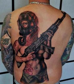 Gas Mask Back Pin Up Tattoo - Benjamin Laukis,  Go To www.likegossip.com to get more Gossip News!