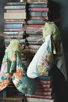 Moths on Books - just WOW http://www.thisiscolossal.com/2014/12/new-vintage-textile-flora-and-fauna-sculptures-by-mister-finch/