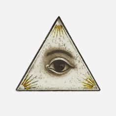 Lot 204: Masonic. Eye of Providence. Early 20th Century, reverse-painted glass, lead. 7¼ w x ¼ d x 6¼ h in. estimate: $500–700.