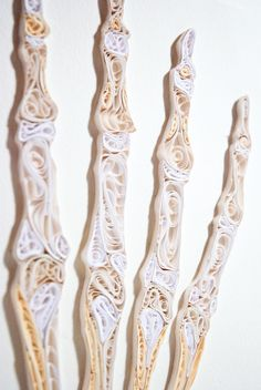This beautiful anatomical art is made of paper, not flesh and bone.    Method: Quilling    Artist: Sarah Yakawonis. Could be done with masking like as does Danny Scheible