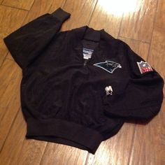 YOUTH MEDIUM PANTHERS PULLOVER WIND JACKET Nylon Wind Jacket with two front pockets - Gently worn.  Great Condition! Starter Jackets & Coats