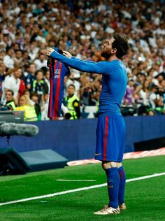 Barcelona's Argentinian forward Lionel Messi celebrates after scoring during the Spanish league Clasico football match Real Madrid CF vs FC Barcelona at the Santiago Bernabeu stadium in Madrid on April / AFP PHOTO / OSCAR DEL POZO Fc Barcelona, Real Madrid And Barcelona, Lionel Messi Barcelona, Messi Funny, Clasico Real Madrid, Barca Real, Lionel Messi Wallpapers, Messi Vs, Football Memes